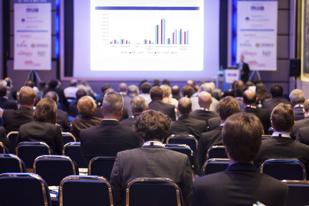 Delegates watching a business presentation during a conference